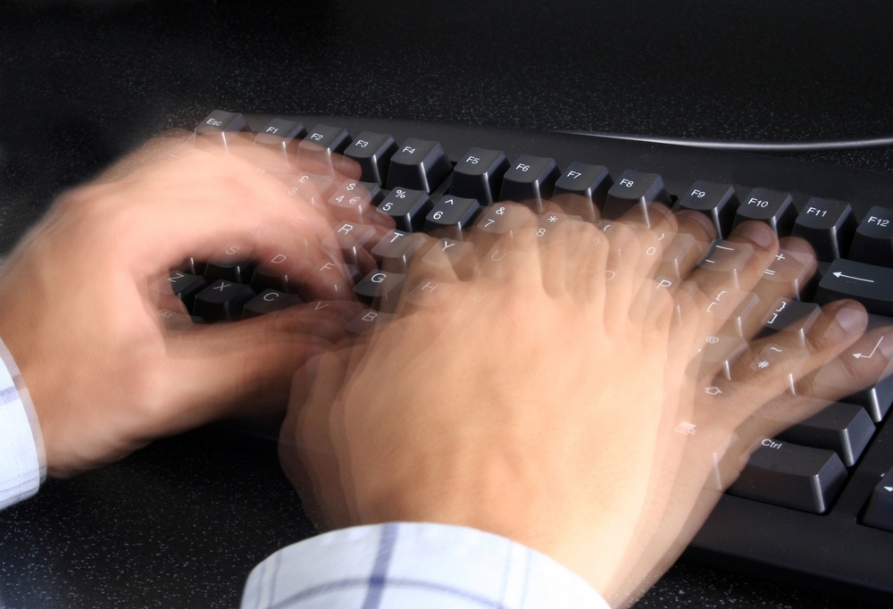person typing incredibly fast on a keyboard.jpeg